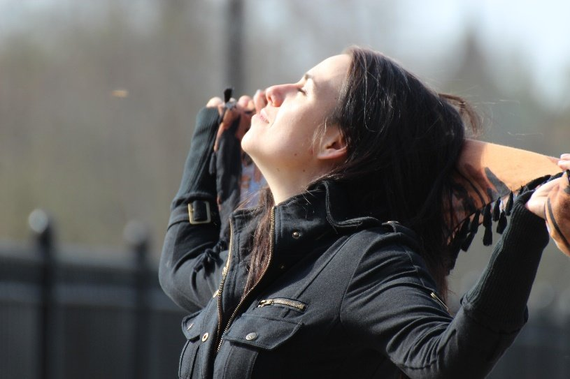 Woman taking in the fresh air looking peaceful