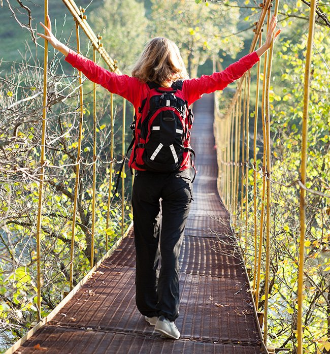Woman hiking on a bridge